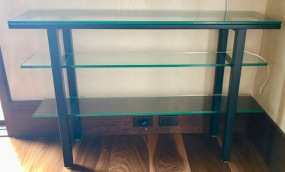 Several glass and dark metal side tables